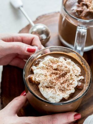Homemade hot chocolate is the perfect sweet treat and drink to celebrate the holidays! This recipe cooks in the Instant Pot or Slow Cooker to make things easy for holiday entertaining. #instantpot #slowcooker #homemade #hotchocolate #recipe