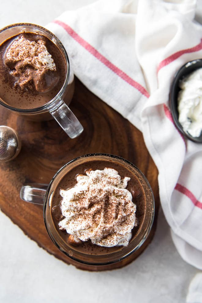 Homemade hot cocoa is the perfect sweet treat and drink to celebrate the holidays! This recipe cooks in the Instant Pot or Slow Cooker to make things easy for holiday entertaining. #chocolate #hot #drink #instantpot #slowcooker #holiday #recipe