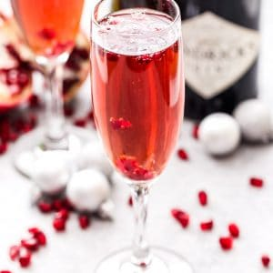 Pomegranate French 75 is the perfect drink to add to toast with this holiday season and a must for brunch! Bubbly, sweet and floral with a touch of tart flavor from the pomegranate. #French75 #pomegranate #cocktail #champagne #christmas #newyearseve #valentinesday #brunch