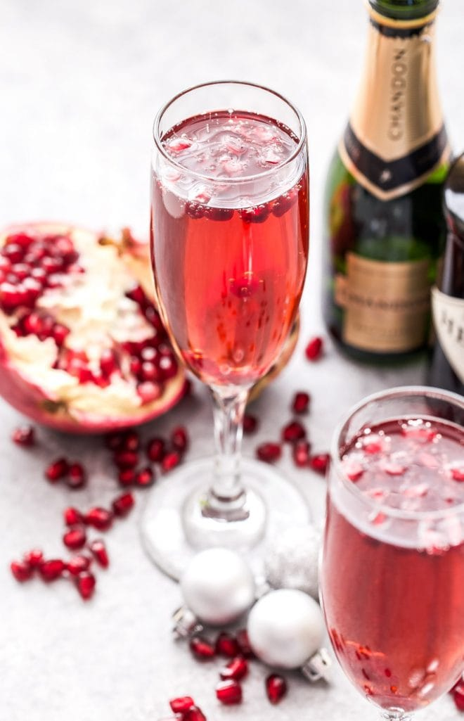 Pomegranate French 75 is the perfect drink to toast with this holiday season and a must for brunch! Bubbly, sweet and floral with a touch of tart flavor from the pomegranate. #French75 #pomegranate #cocktail #champagne #christmas #newyearseve #valentinesday #brunch