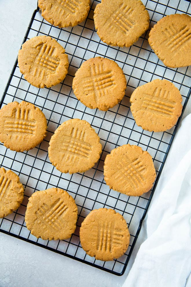 If you are looking for the best peanut butter cookies, these 3 ingredient peanut butter cookies are a crowd favorite! The cookies are made with only three ingredients and are the perfect treat for holiday cookie swaps and parties. #peanut #butter #cookies #holiday #cookieswap #peanutbutter #recipe #easy #dessert
