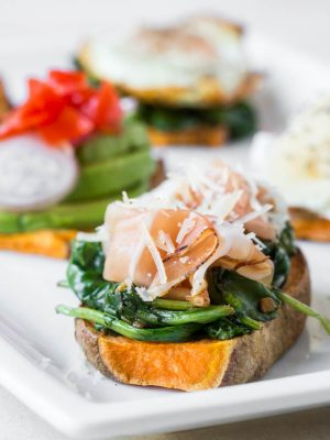 Sweet potato toast is an easy breakfast, lunch, snack or dinner option! Bake the sweet potato in the oven or toaster, top with your favorite ingredients like greens, prosciutto, and more. #sweetpotato #toast #recipe #healthy #snack