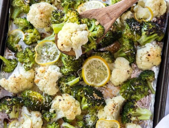 Roast cauliflower and broccoli with lemon, garlic and a few other simple ingredients to create this easy and healthy side dish recipe. #broccoli #cauliflower #lemon #garlic #roasted #dinner #recipe #mealplan