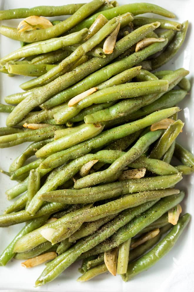 Follow this simple recipe for how to cook fresh green beans to make these Garlic Green Beans! The green beans cook in one skillet in less than 15 minutes. They are a delicious side dish packed with fresh flavor. #greenbeans #healthy #sidedish #skillet #dinner #recipe #fresh #clean #quick #inexpensive