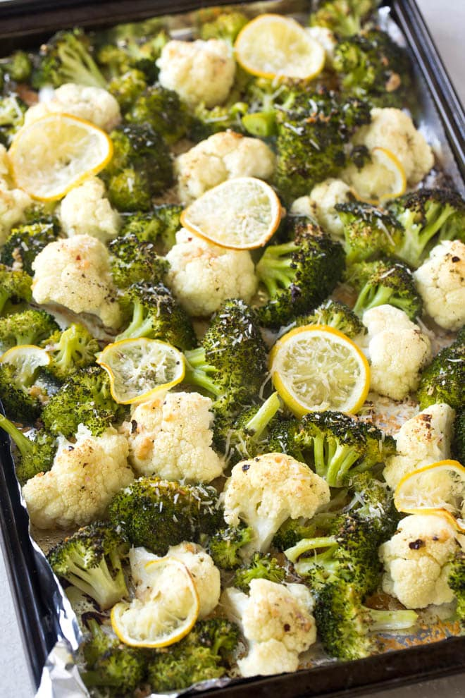 Lemon Garlic Roasted Broccoli and Cauliflower is a simple side dish made with only a few ingredients! #roasted #broccoli #cauliflower #lemon #garlic #sidedish #recipe #dinner #mealprep