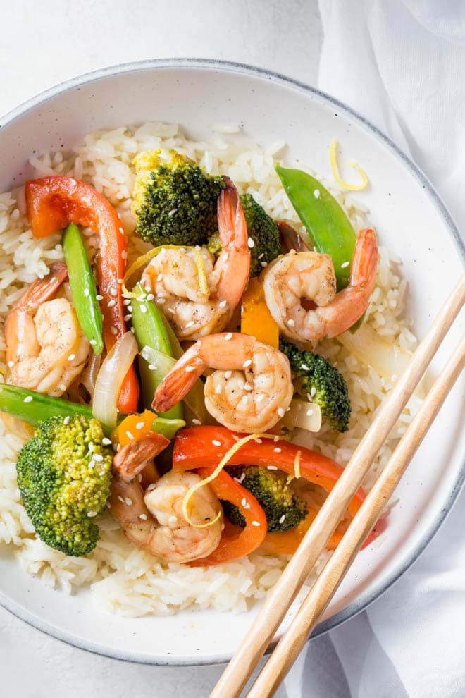Shrimp Stir Fry with Lemon and Ginger is a simple and healthy meal made in less than 30 minutes! Combine your favorite stir fry vegetables and flavors to create this easy dinner recipe.