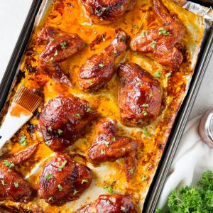 Baked bbq chicken includes an assortment of wings, drumsticks and thighs made with an easy bbq sauce. #bbq #chicken #wings #thighs #drumsticks #dinner #recipe #healthy