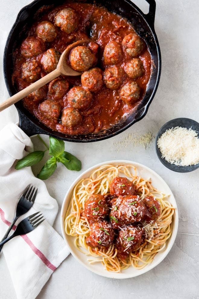 Baked Italian turkey meatballs are a classic turkey meatball recipe that is perfect for dinner any day of the week! Combine a few simple ingredients to make these healthy turkey meatballs and serve with sauce and spaghetti for a complete meal. #baked #turkey #italian #meatballs #recipe #dinner #pasta #weeknight #meal