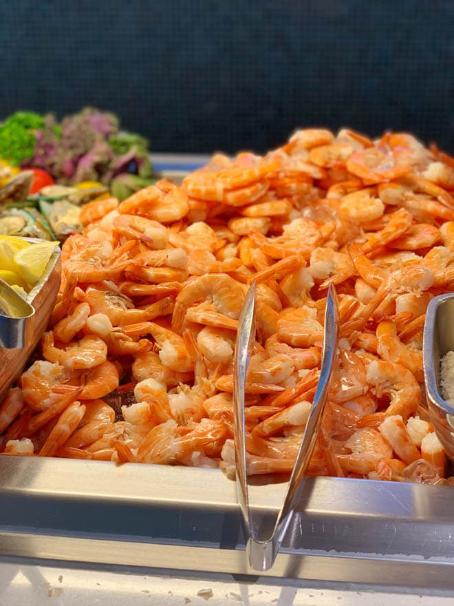 A large pile of cooked shrimp at a buffet at Cabanas on the Disney Dream