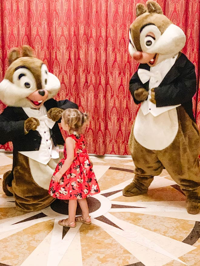 Toddler girl with chip and dale.