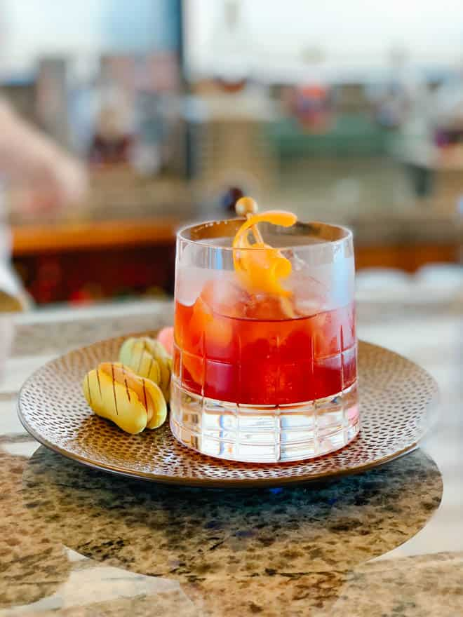 Glass of cocktail sitting on a bar on the Disney Cruise