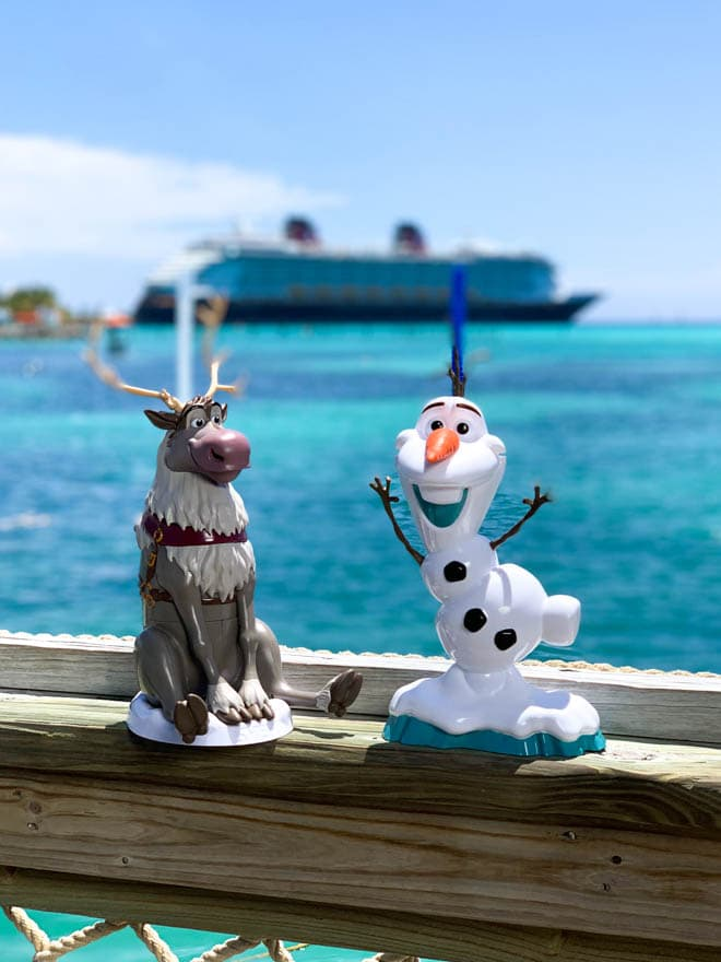 Olaf and Sven cups near heads up bar overlooking the Disney dream cruise ship.