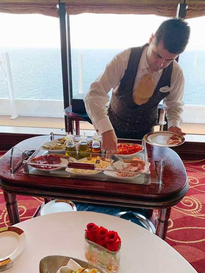 Waiter serving from an antipasto cart at Palo Disney Dream.