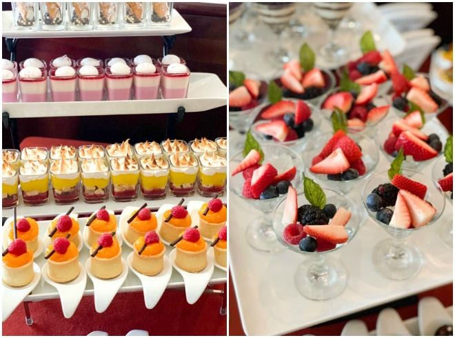 A tower of different desserts with berry fruit cups and mousse.