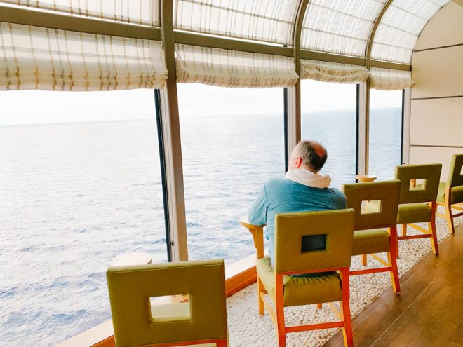 chairs overlooking the ocean on a cruise ship