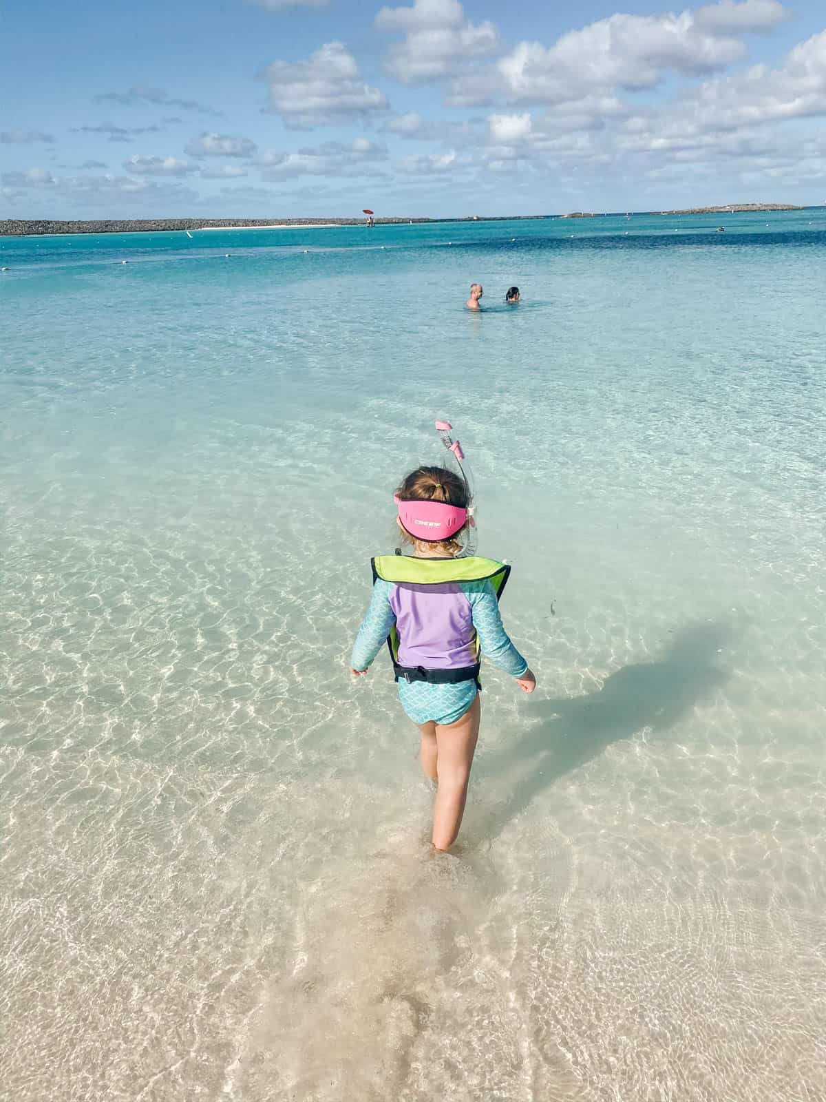 girl walking into the water to snorkel at castaway cay