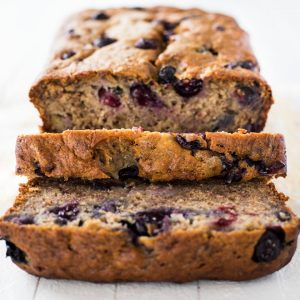 a loaf of blueberry banana bread cut into slices