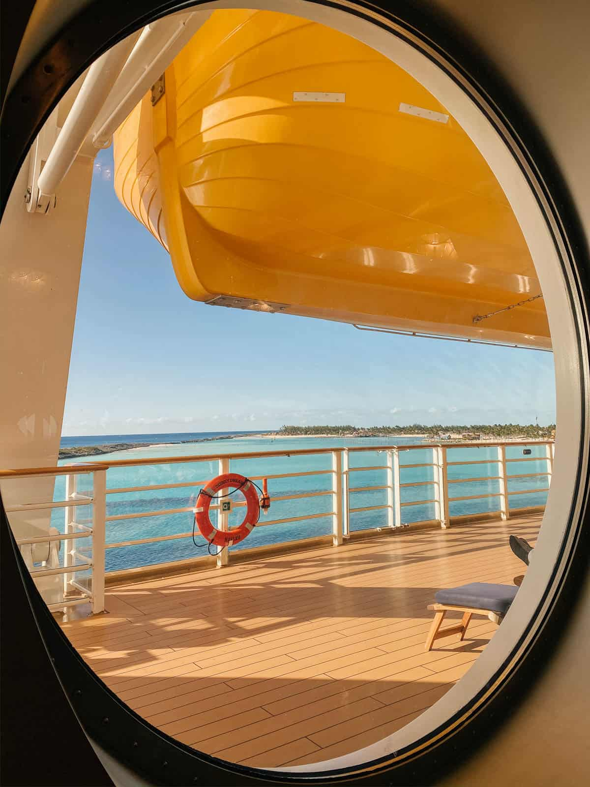 looking out port hole from disney dream cruise ship overlooking castaway cay