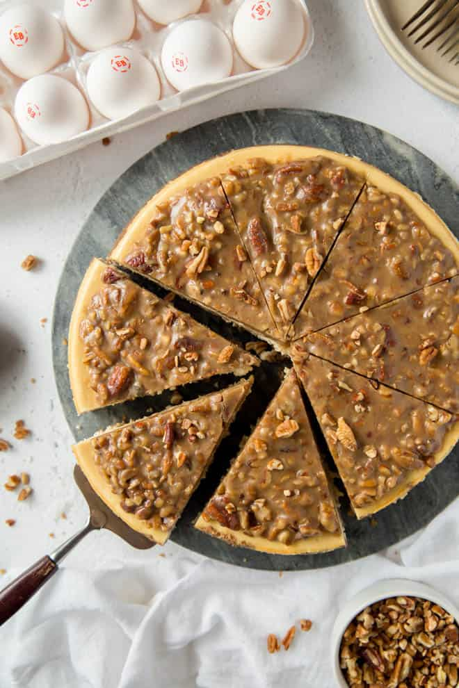Three slices cut into pecan pie cheesecake.