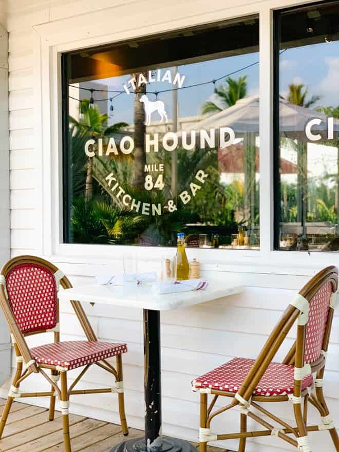 Table and two chairs at Ciao Hound restaurant.