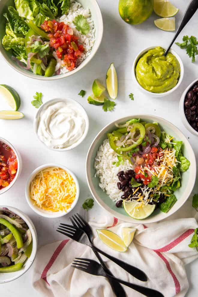 A large burrito bowl and all of the burrito bowl toppings.