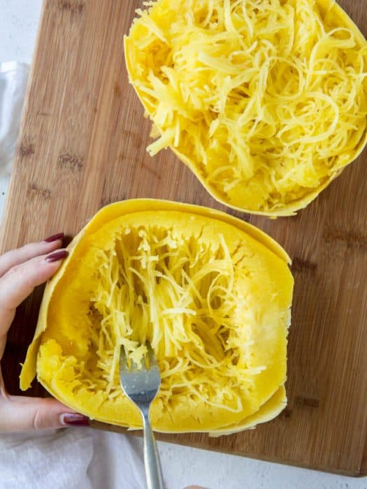 scooping out spaghetti squash