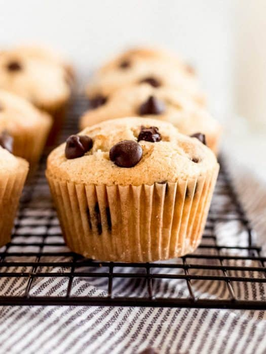 chocolate chip muffins on a baking rack