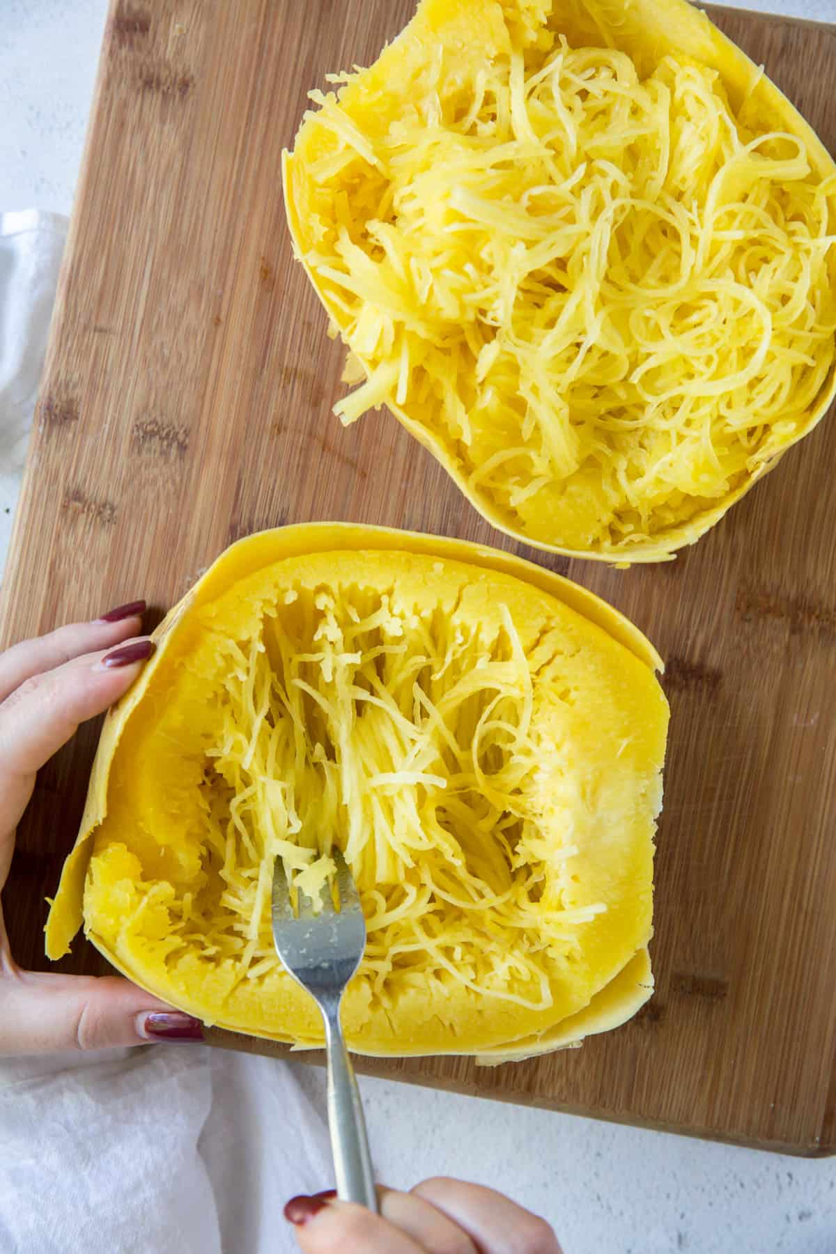 a fork scooping out spaghetti squash