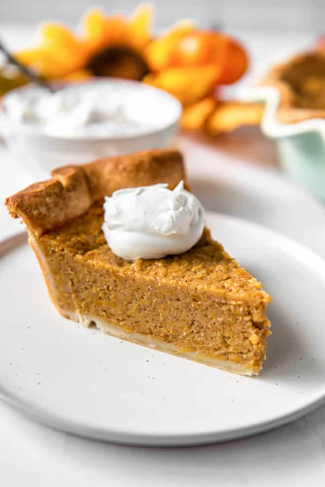 slice of sweet potato pie on a plate