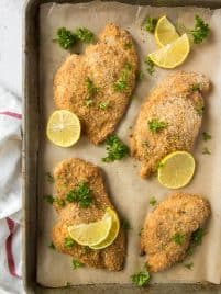 baked chicken cutlets on a sheet pan