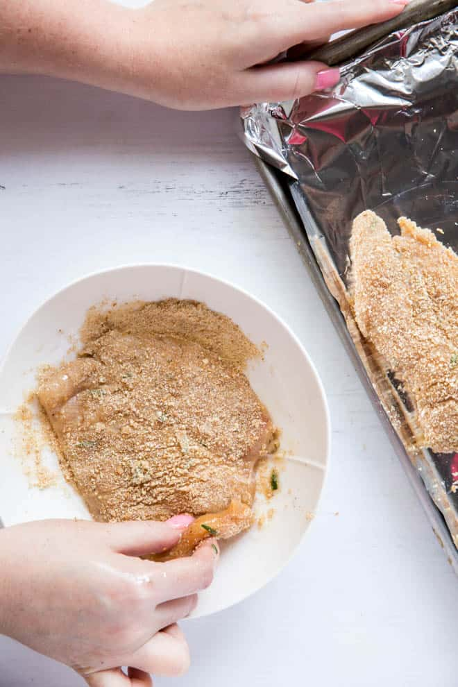 chicken cutlet in a bowl with breadcrumbs