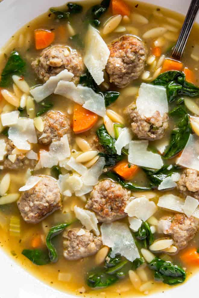 meatballs, greens, vegetables and fresh ingredients in Italian soup