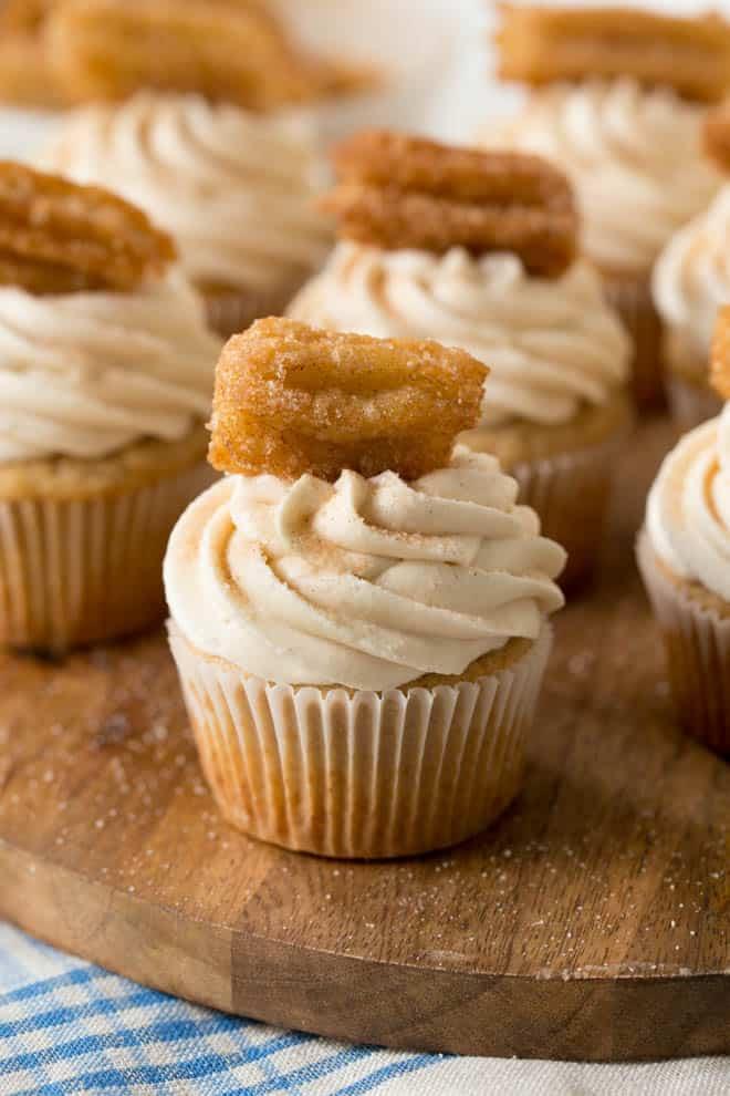 a cinnamon sugar cupcake with homemade churro on top