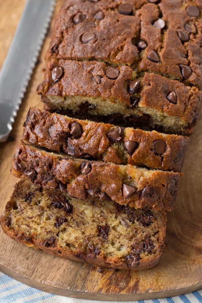 slicing into chocolate chip banana bread