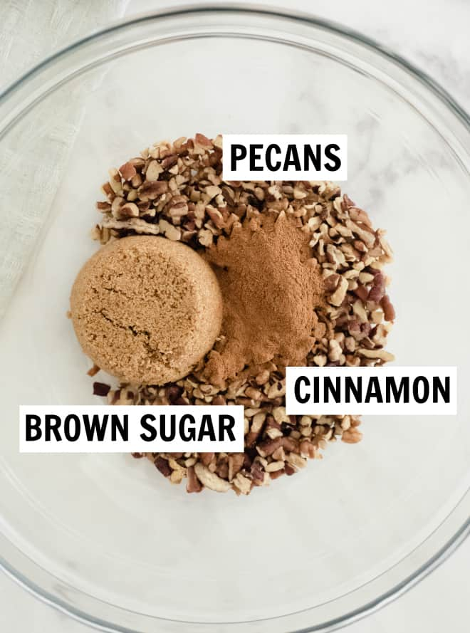 ingredients for streusel topping in a bowl including brown sugar, pecans and cinnamon