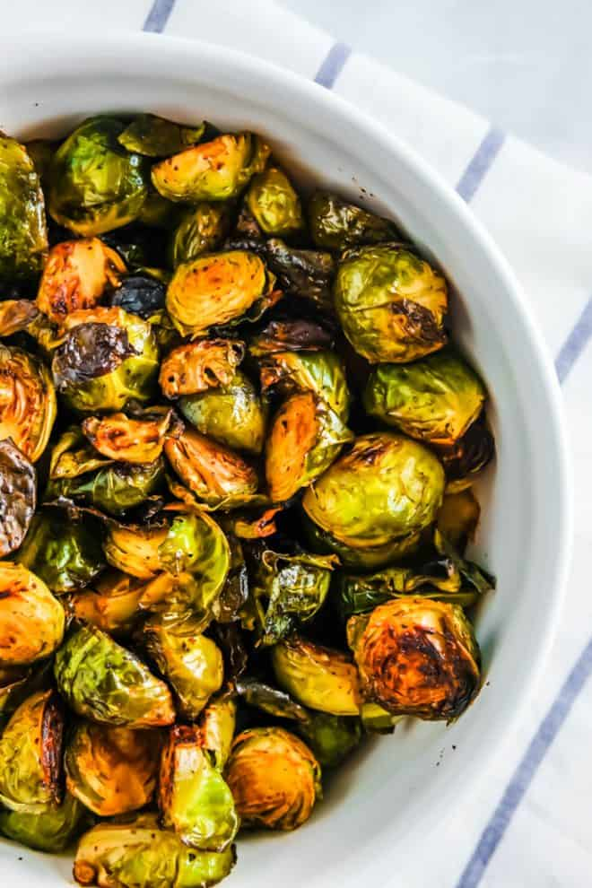 baked brussels sprouts in a white bowl