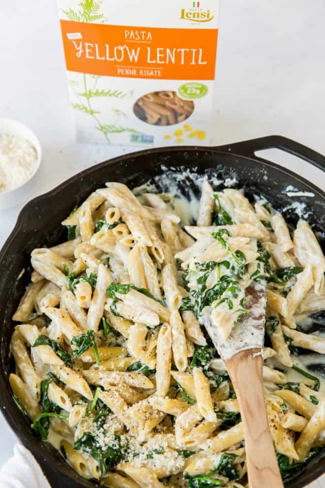 a skillet with spinach and ricotta pasta