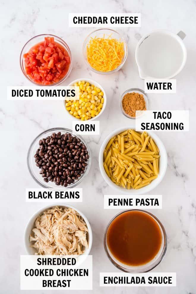 ingredients for chicken enchilada pasta on white countertop