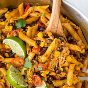 a skillet with chicken enchilada pasta
