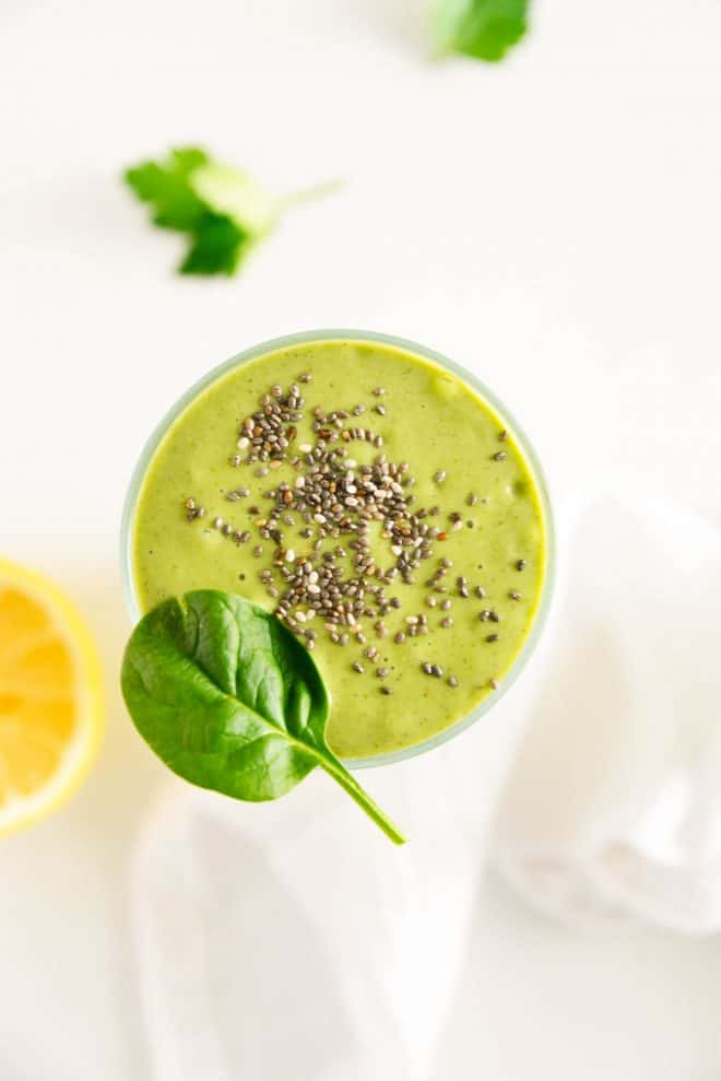an overhead view of a detox smoothie with chia seeds on top