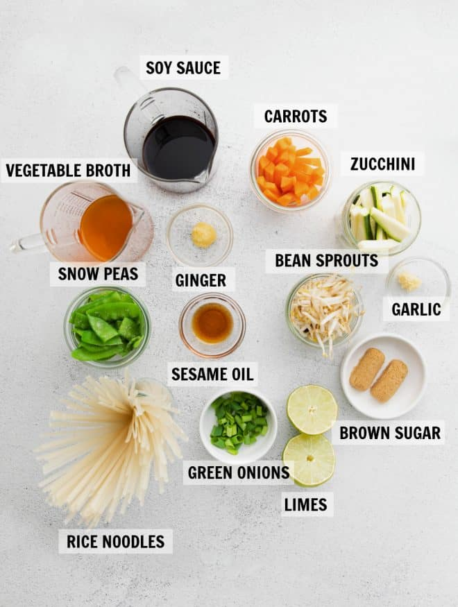All of the ingredients for vegetarian pad thai in glass measuring cups