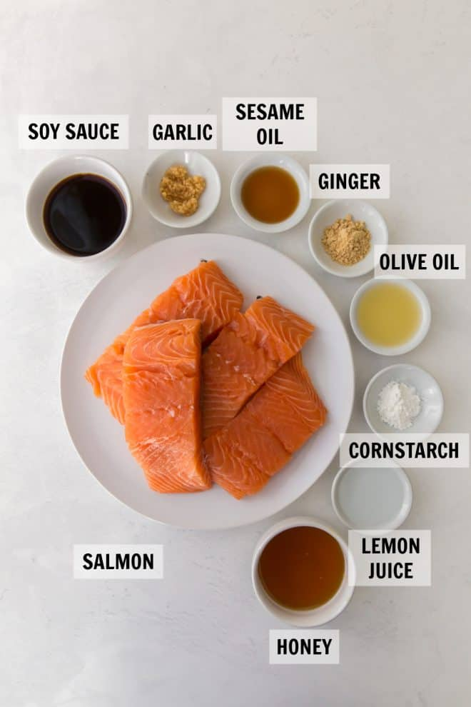 All of the ingredients to make teriyaki salmon in small measuring bowls