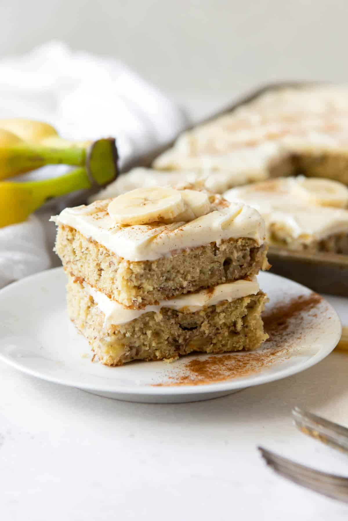 Two banana bars stacked on top of each other on a white plate