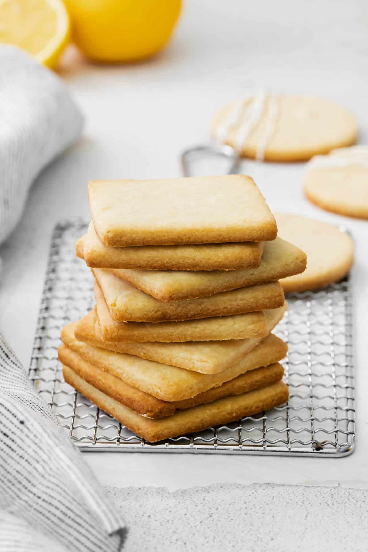 a stack of lemon shortbread cookies on a baking rack