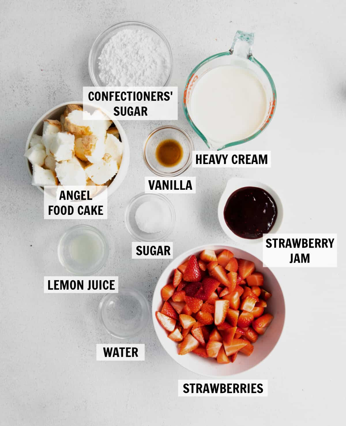 all of the ingredients for a strawberry shortcake trifle sitting on a countertop
