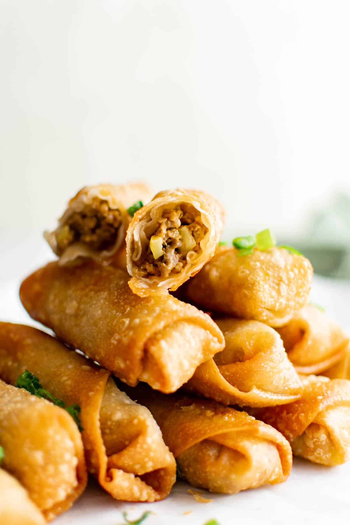 cheeseburger egg rolls stacked on top of each other
