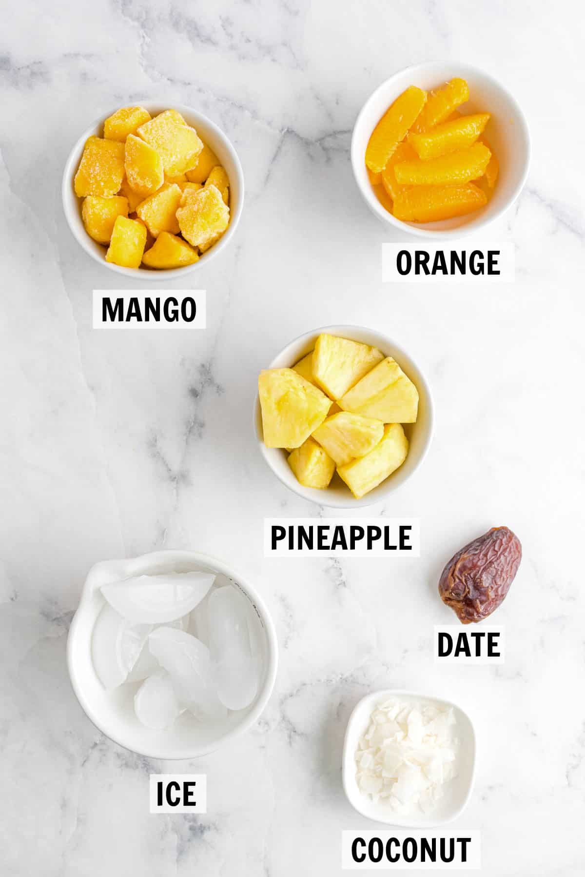 all ingredients for citrus smoothie on countertop