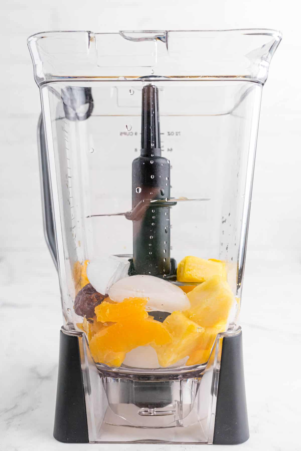 ingredients for citrus smoothie in a blender