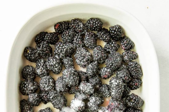 blackberries in baking dish with sugar on top