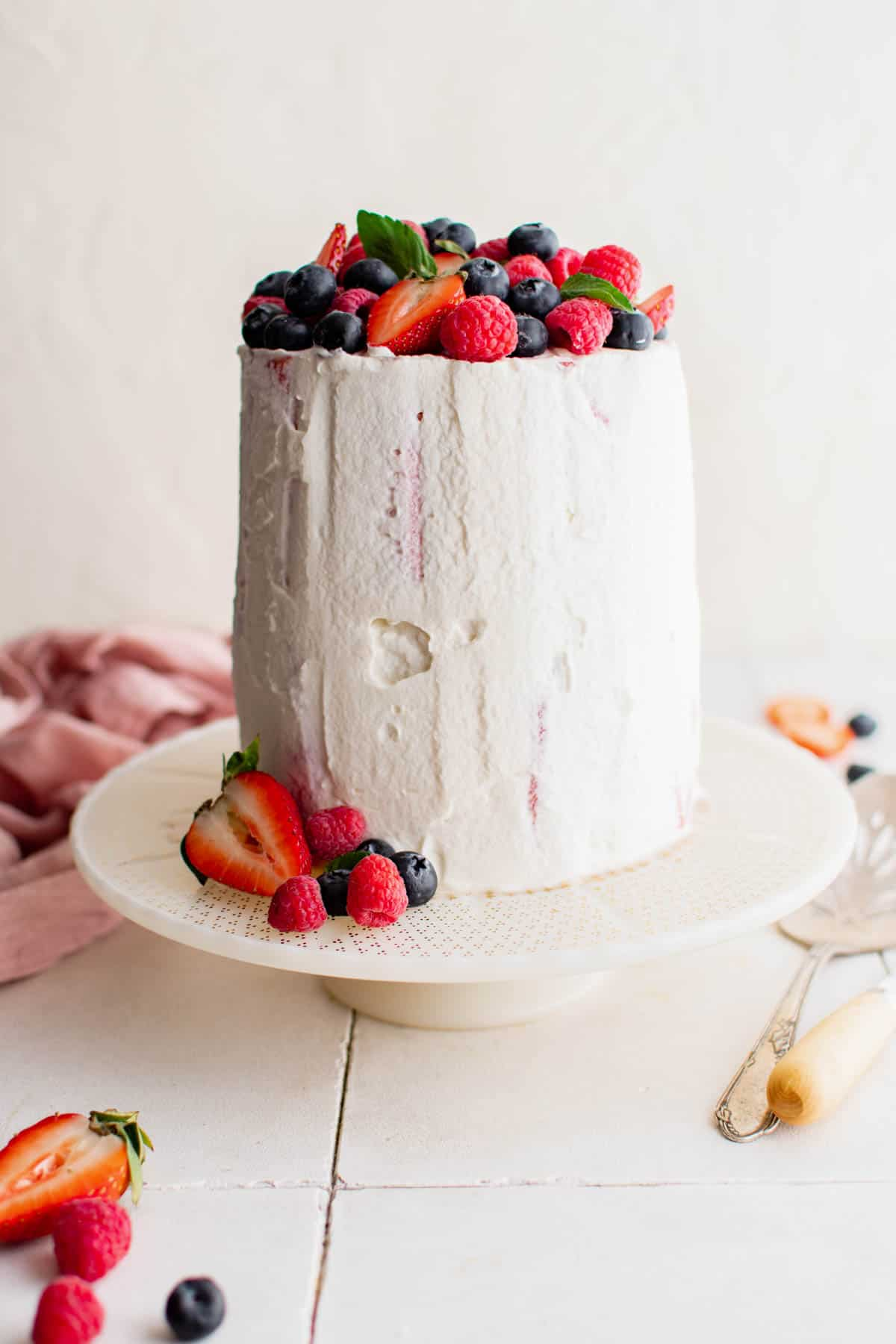 a whole fresh watermelon cake with fresh berries on top